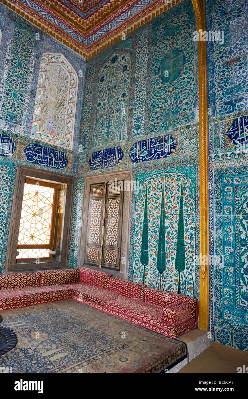 Turkey , Istanbul , Topkapi Palace  settees by window & blue tiles pattern walls & calligraphy panels with - Stock Image