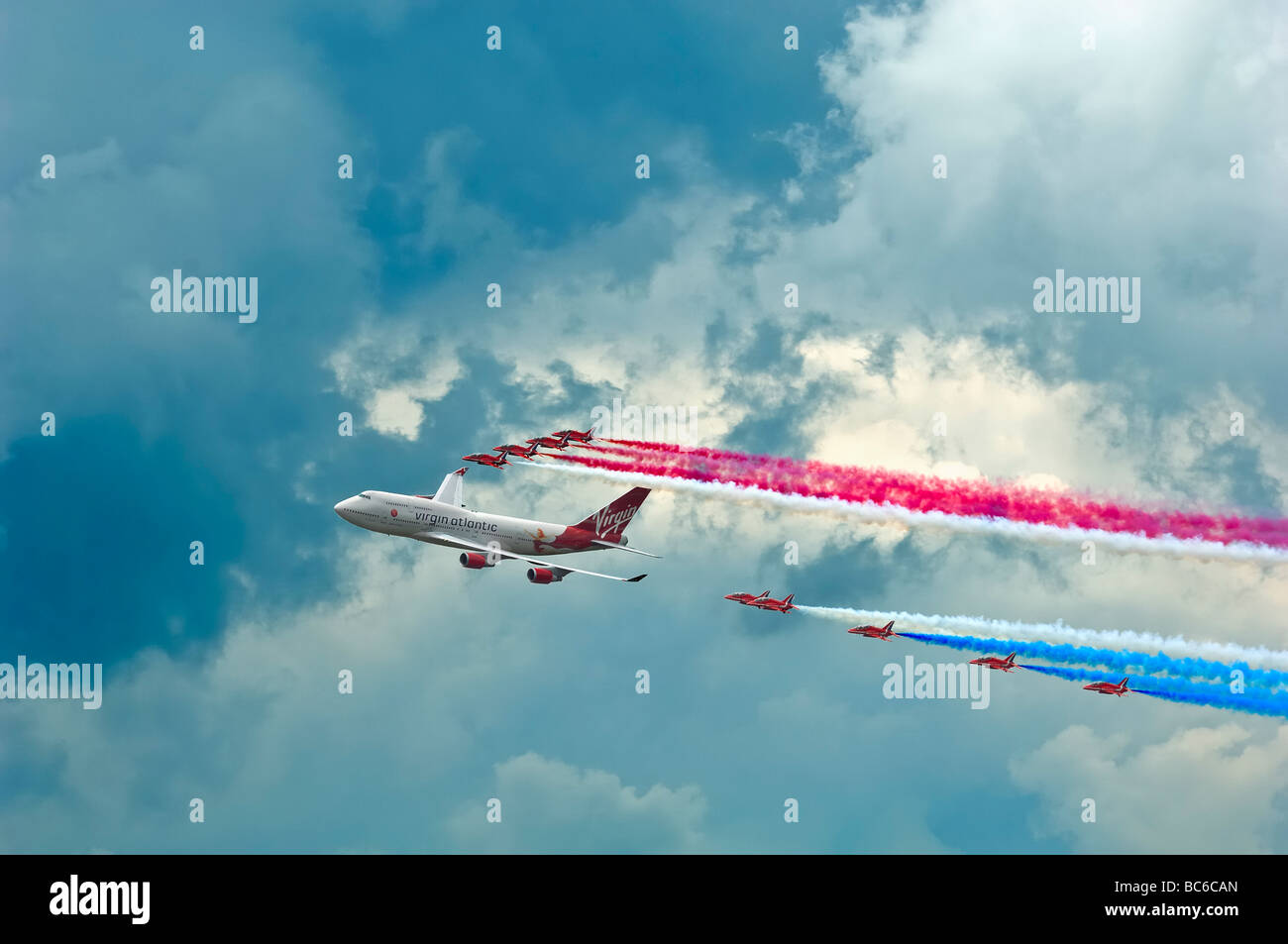 Virgin 747 jumbo fly past with red arrows on 25th anniversary biggin hill airshow 2009 - Stock Image