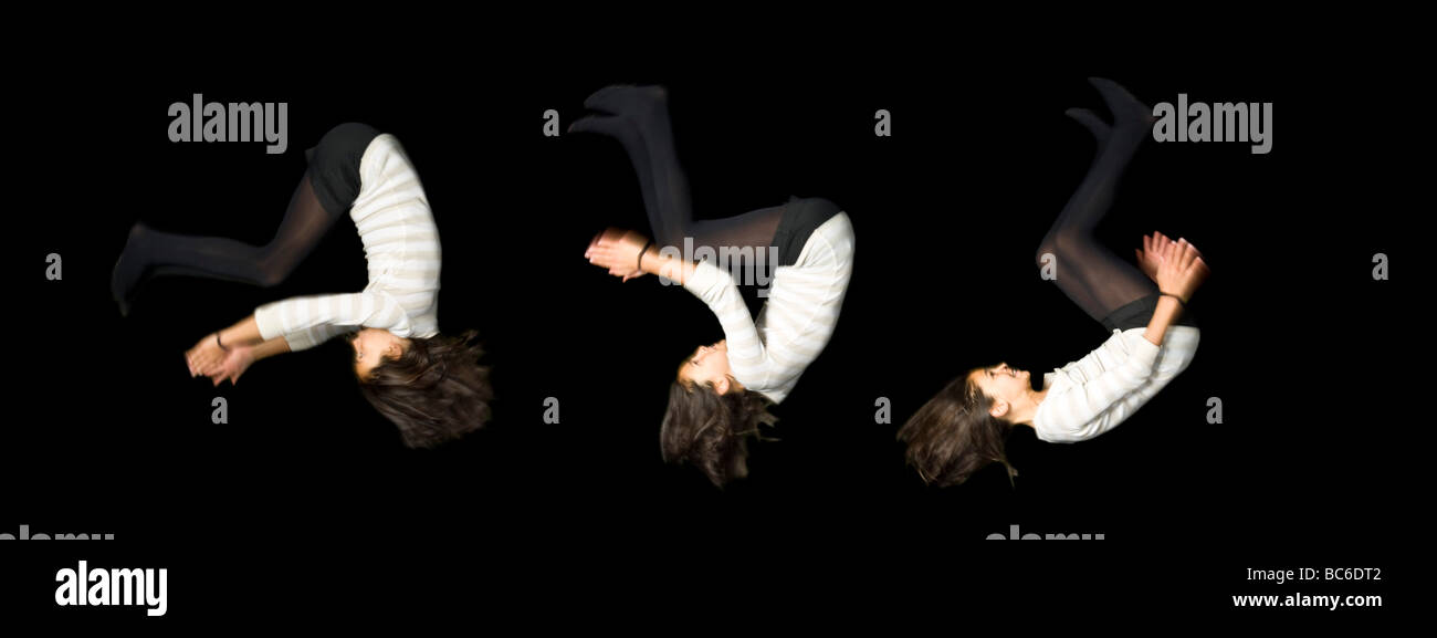 A 3 picture stitch sequence of a young caucasian girl (12) performing a somersault at night on a trampoline. - Stock Image
