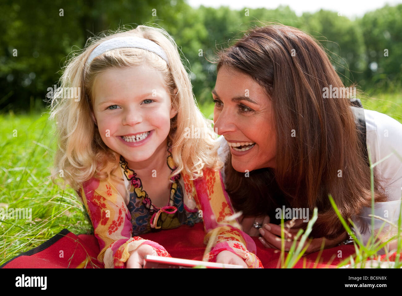 Mother and daughter outdoors together having fun and laughing - Stock Image