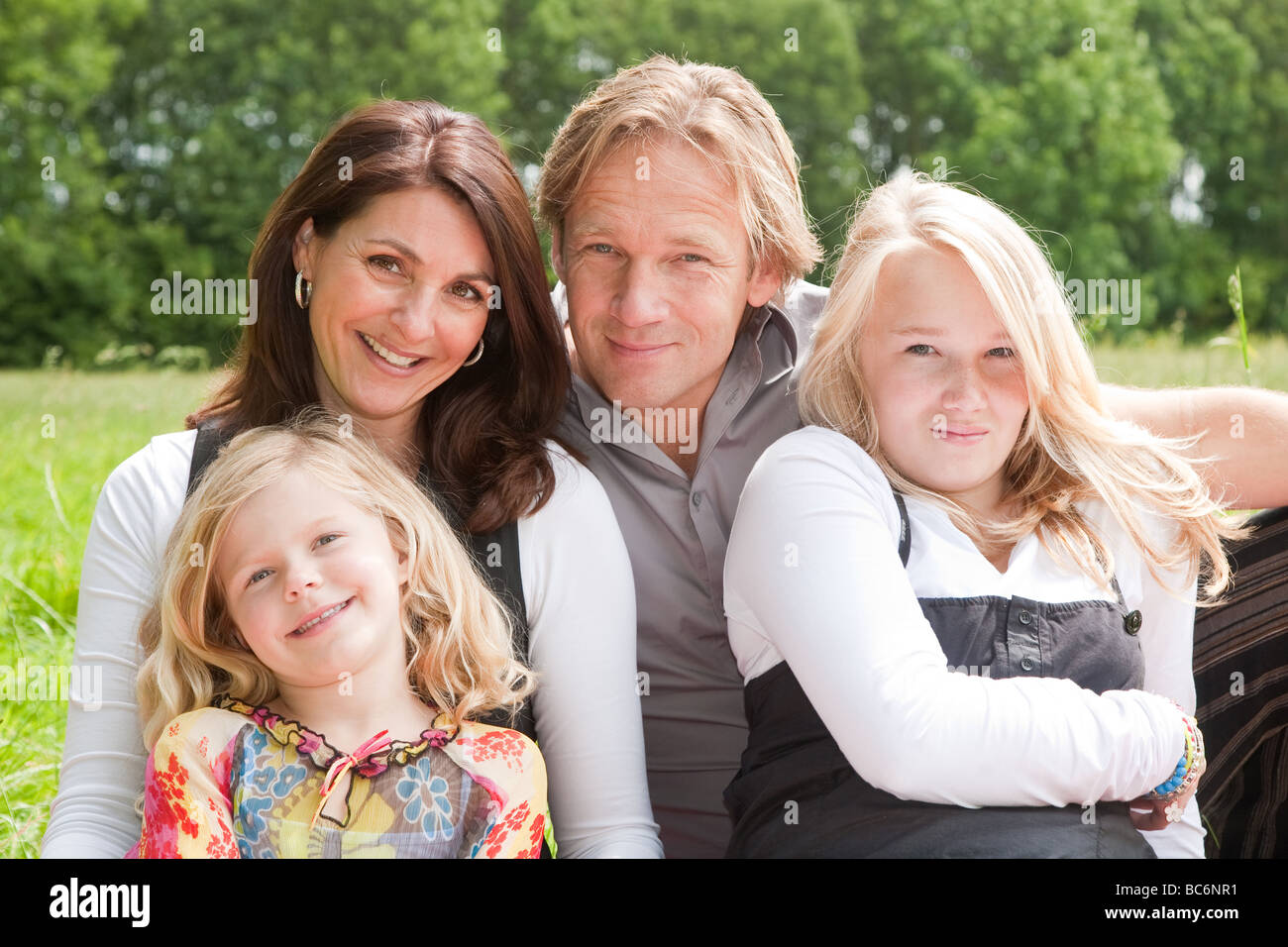 Young family with mother father and two daughters - Stock Image