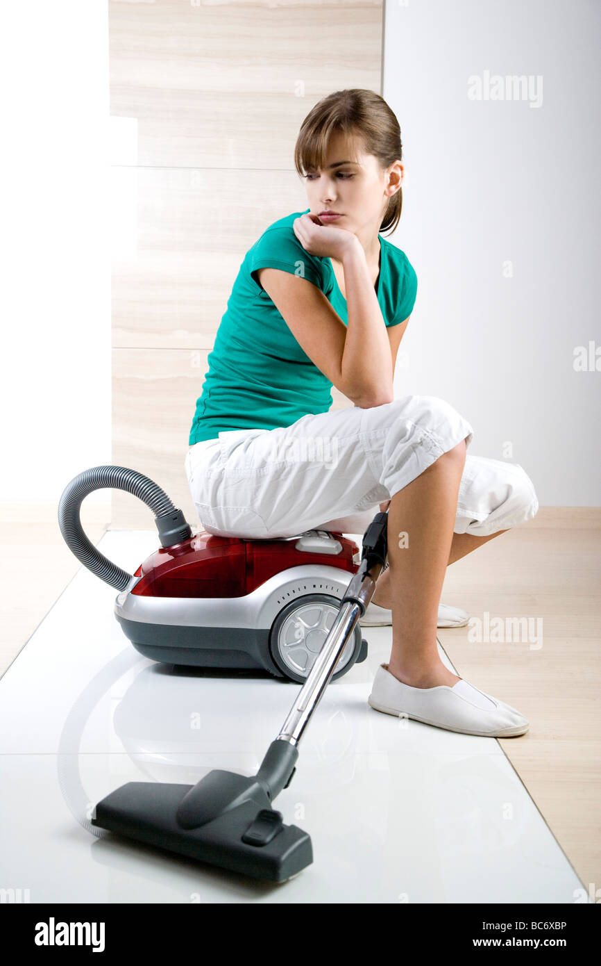 tired woman sitting on hover - Stock Image