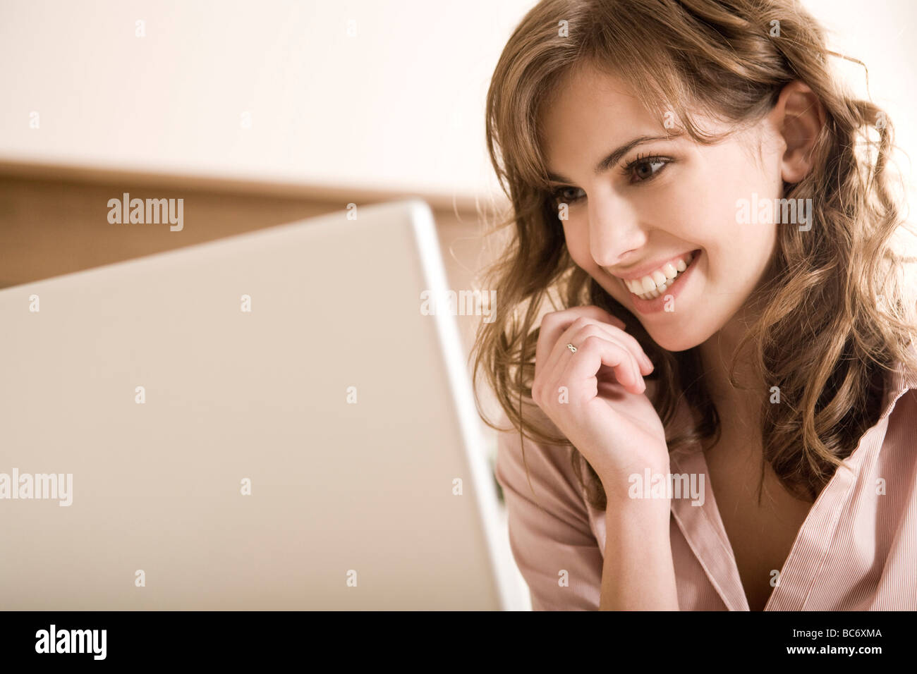 woman on phone with notebook Stock Photo