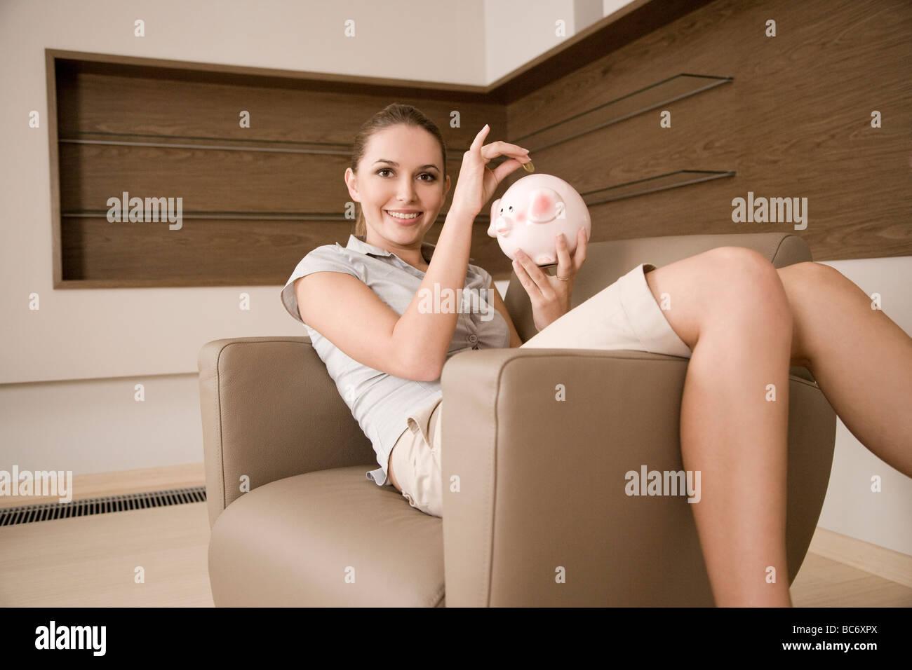 woman saving money - Stock Image