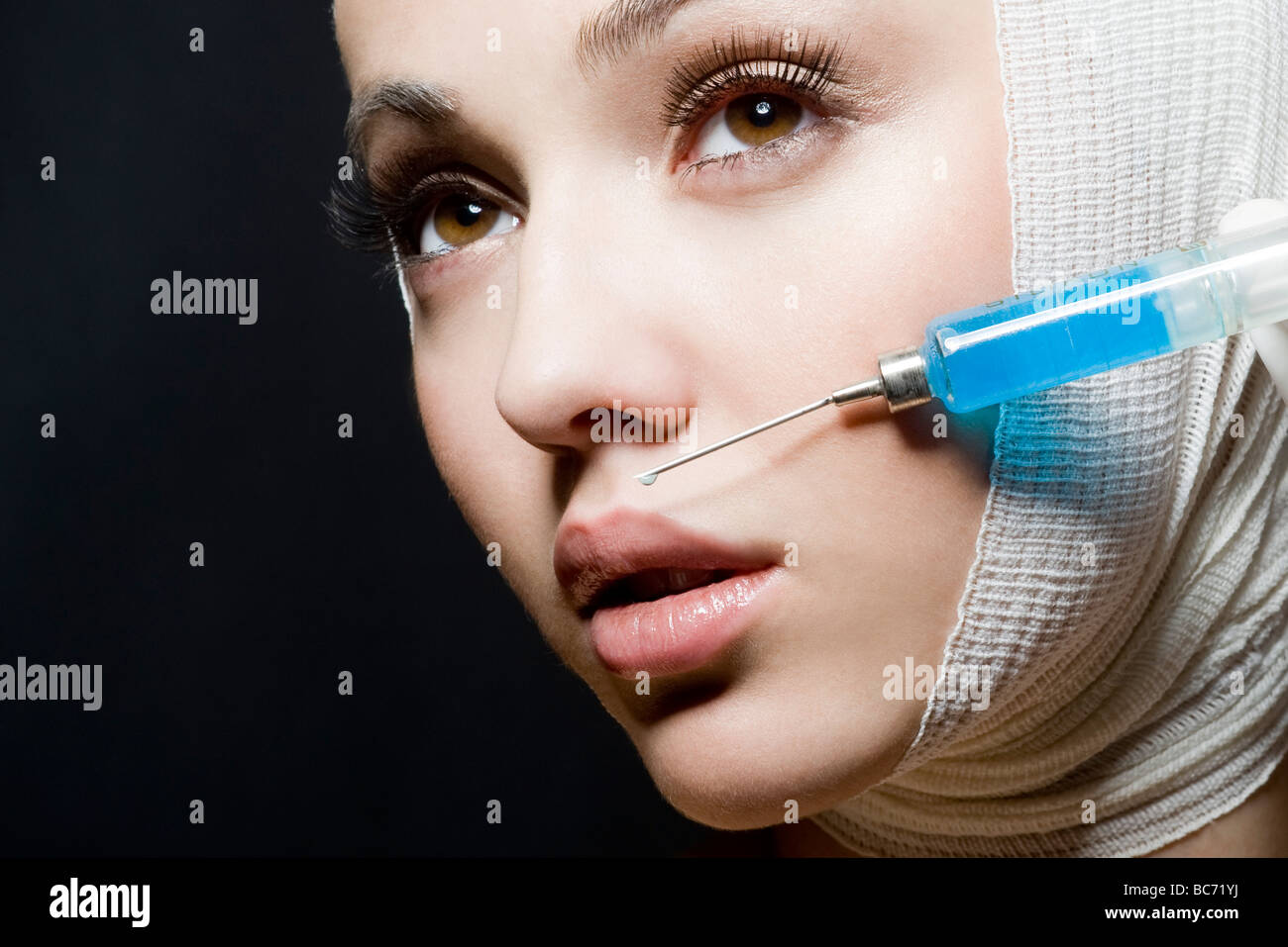 woman receiving bot ox injection - Stock Image
