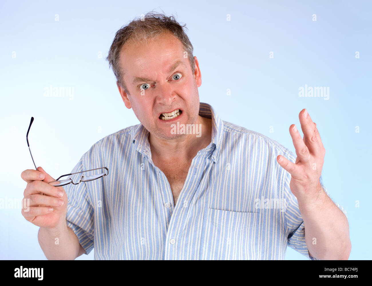 A man is showing his anger about something - Stock Image