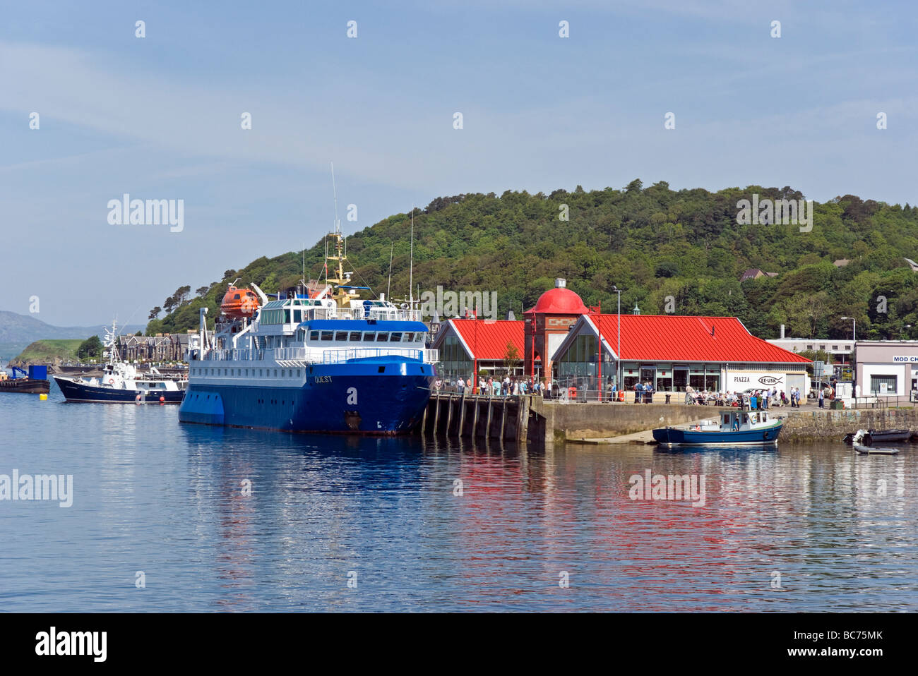 Passenger ship Quest moored at the north pier in Oban harbour - Stock Image