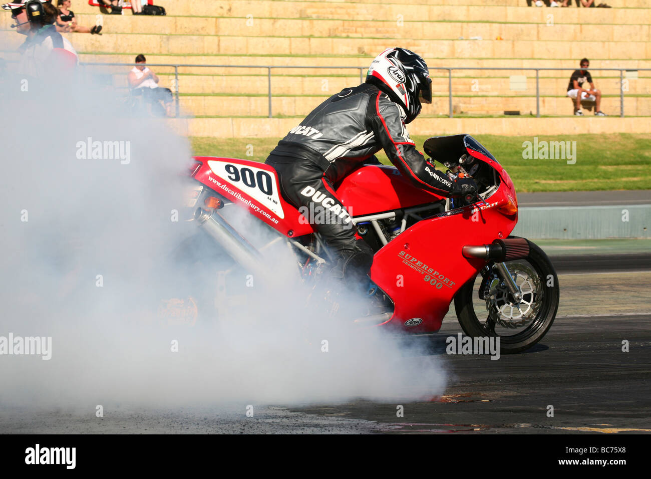 Turbocharged drag racing Ducati 900SS motorcycle performing burnout - Stock Image