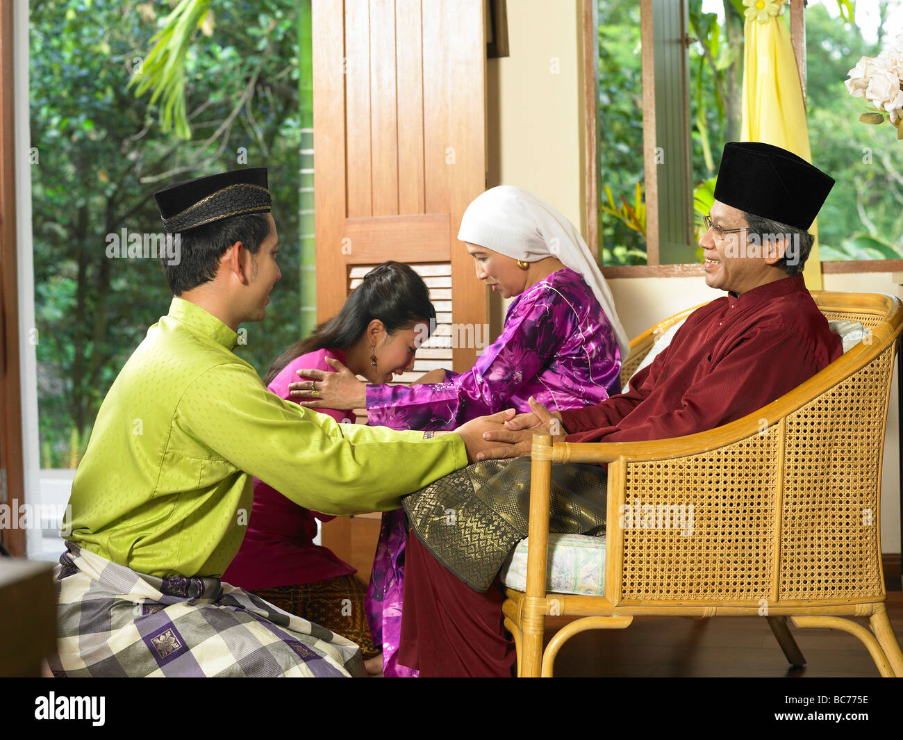 young couple salam with thier parent - Stock Image