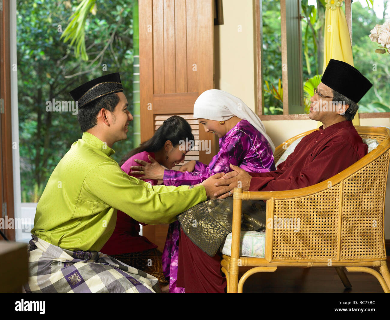 young couple greeting with their parent - Stock Image