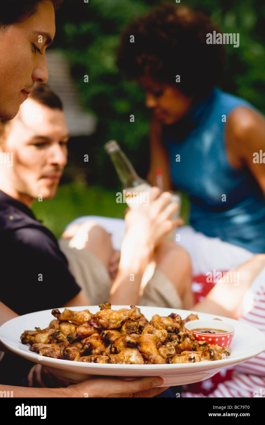 Young people at a 4th of July picnic (USA) - - Stock Image