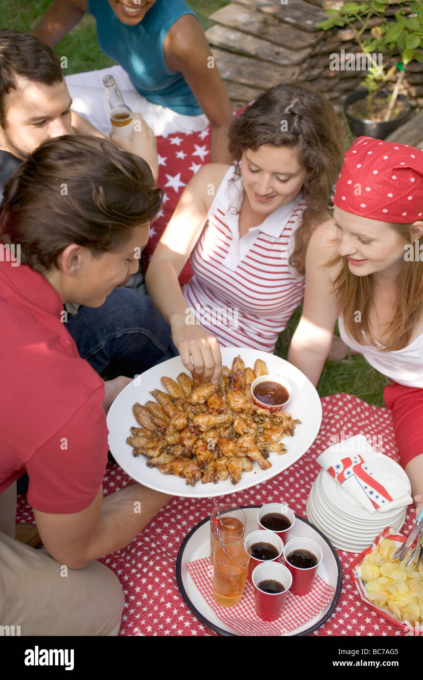 Young people at a 4th of July picnic - - Stock Image