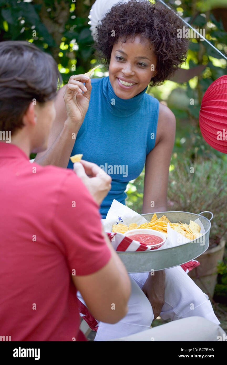Young people with snacks at a 4th of July garden party (USA) - - Stock Image