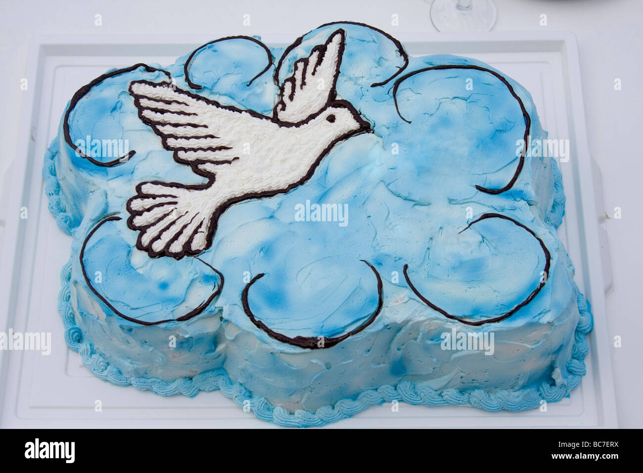 Cake In The Shape Of Blue Cloud And White Bird