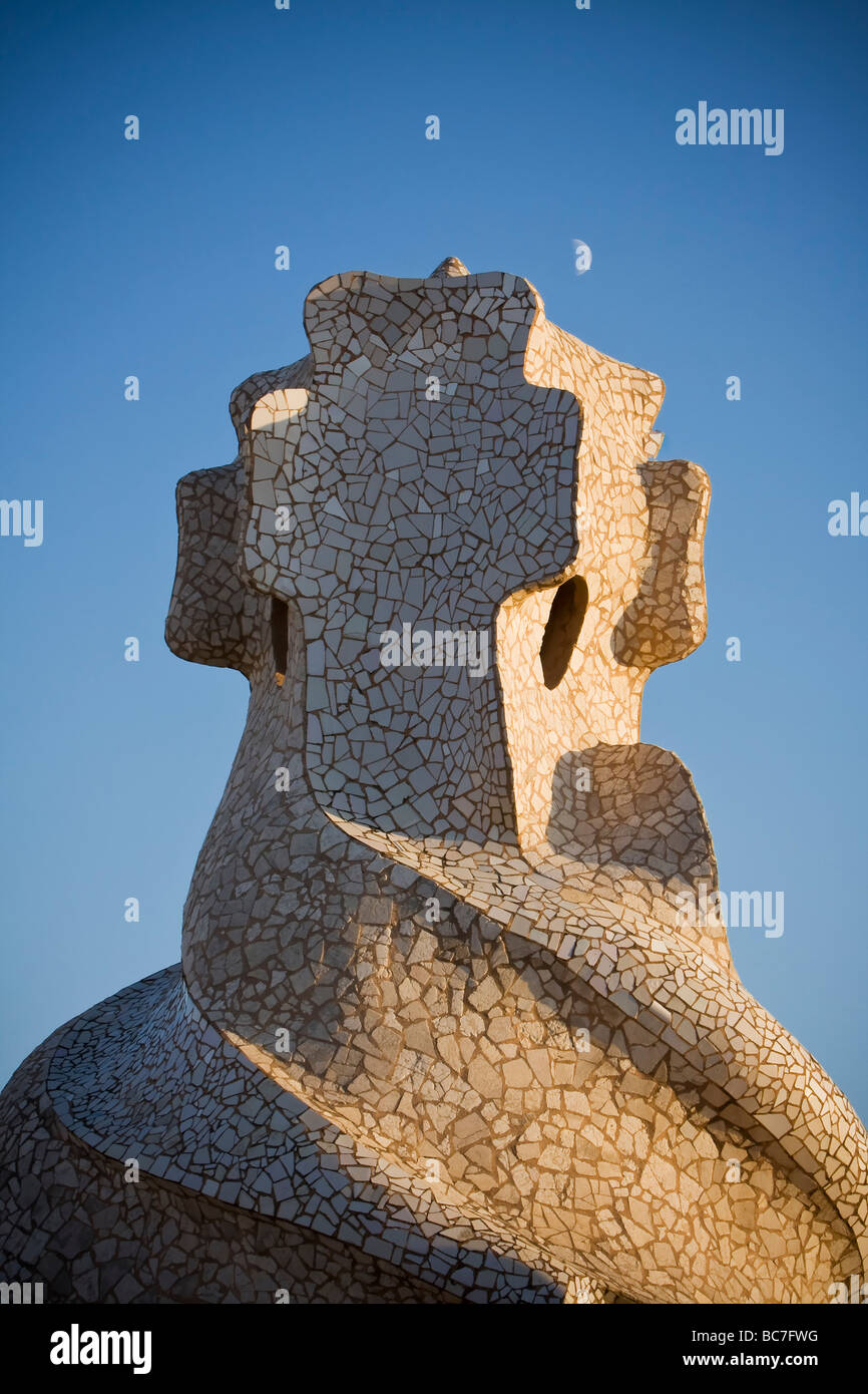 Quarter Moon and Closeup details of mosaic like chimney side lighted by sunset at rooftop of Casa Milà Barcelona - Stock Image