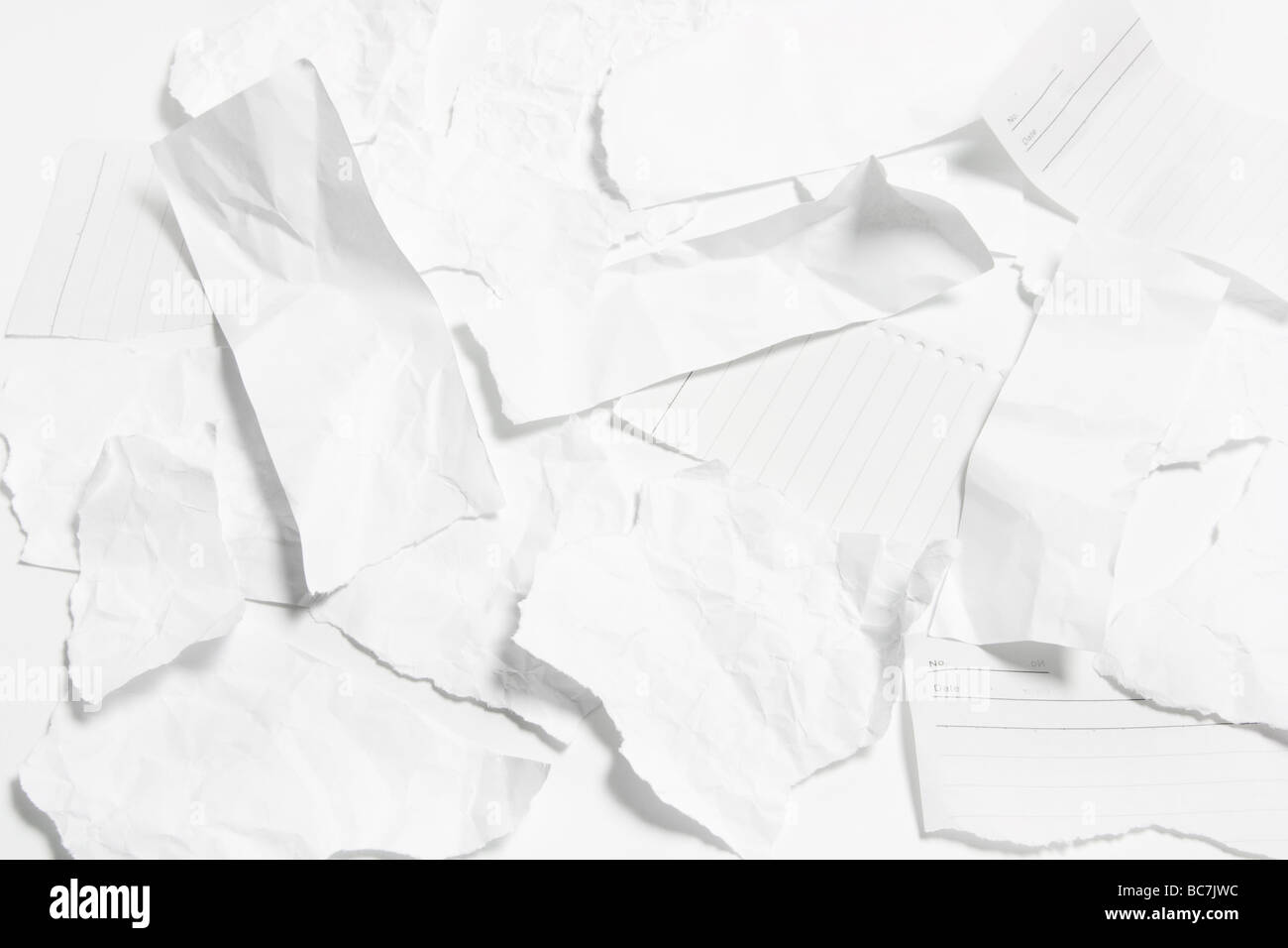 Torn Pieces of Paper - Stock Image