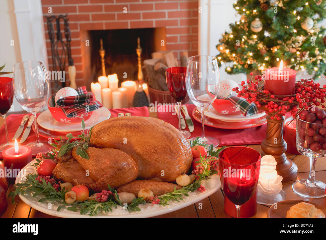 christmas table with turkey in front of fireplace usa stock image