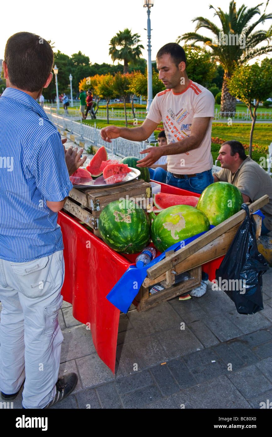 Turkey , Istanbul , Sultanahmet Square or Meydani , vendor sells delicious ripe deep red water melon pieces - Stock Image