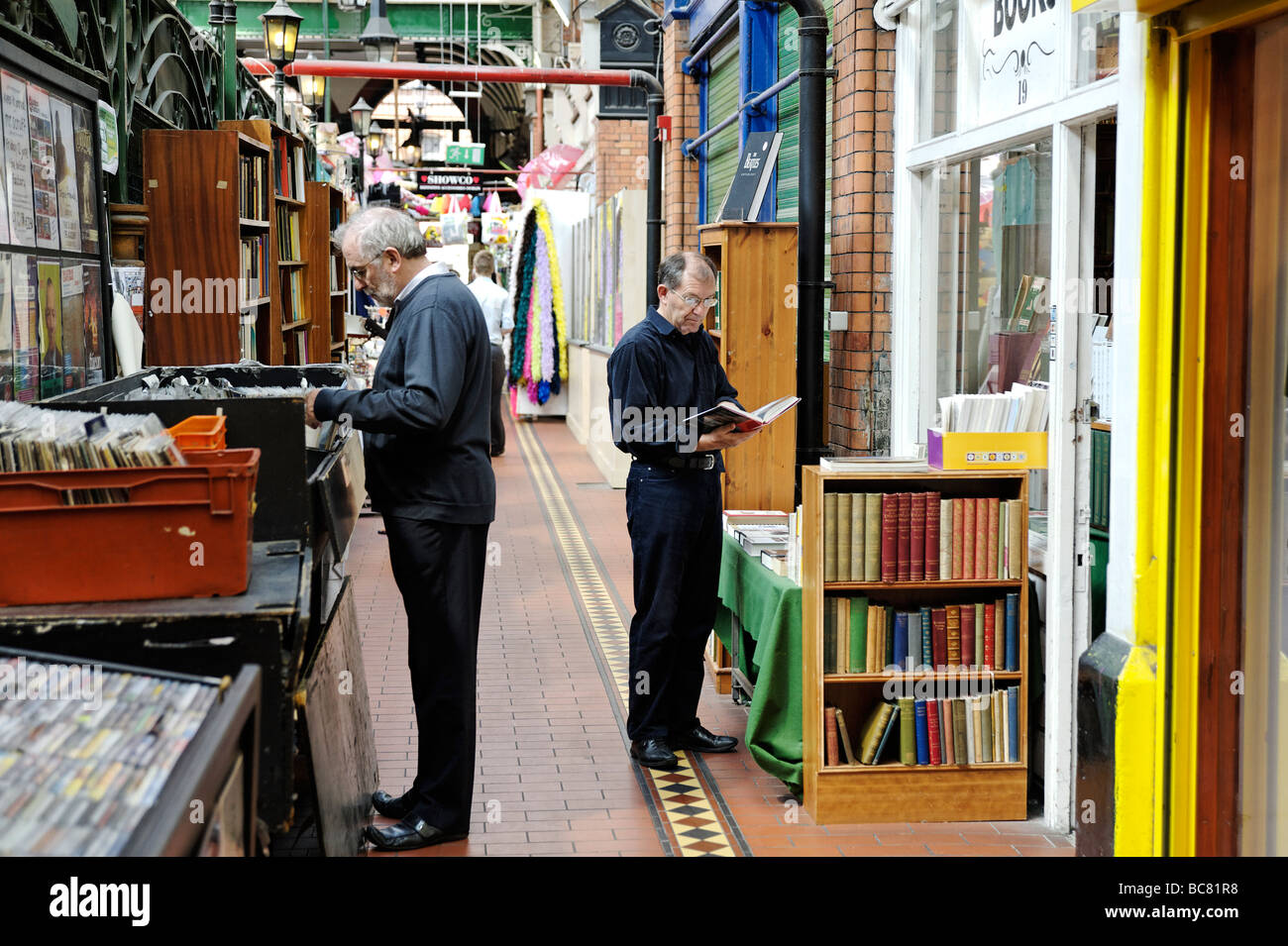 Second hand book stall in South City Market aka George s Street Arcade in Dublin Republic of Ireland - Stock Image