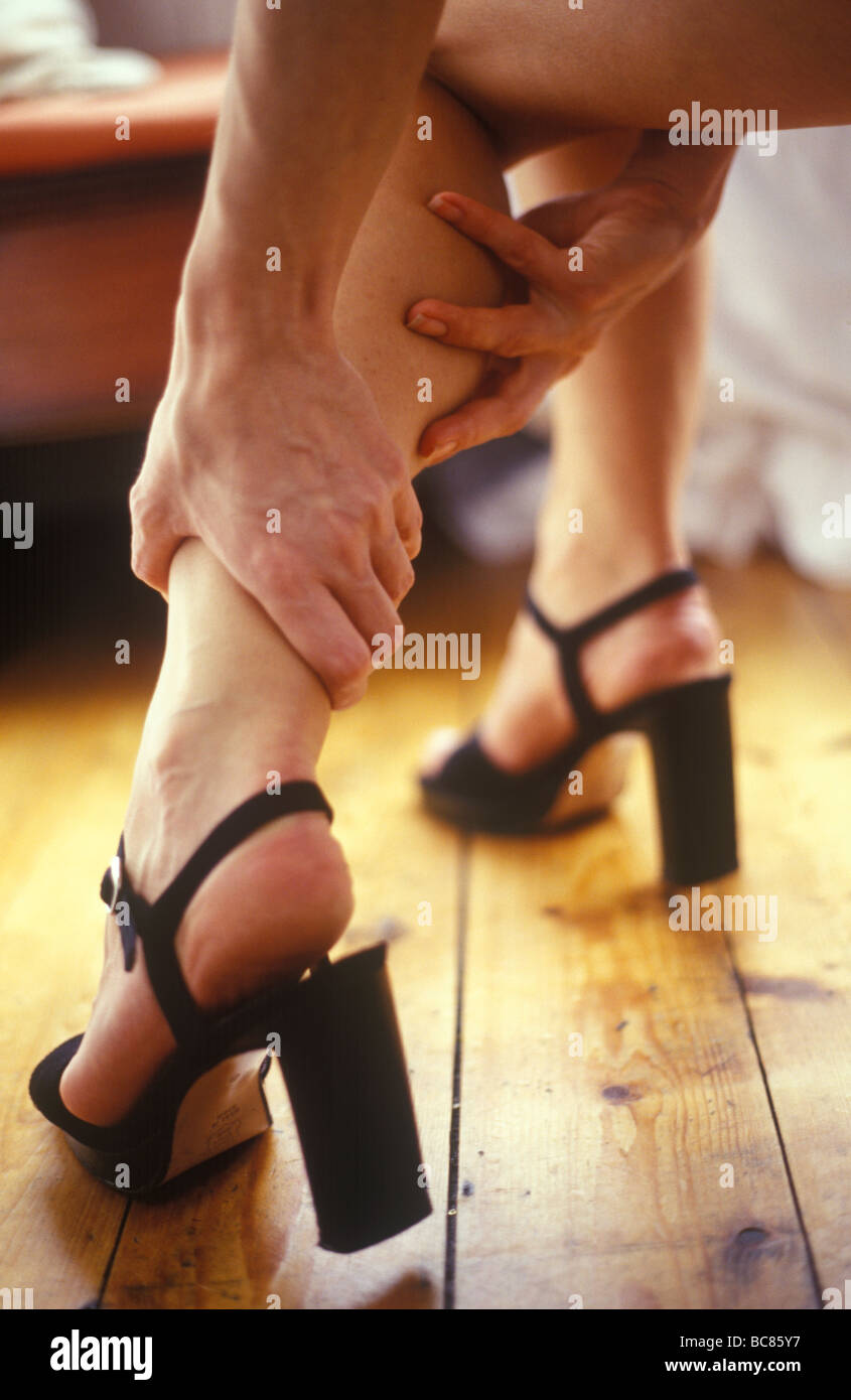 Woman wearing high heel shoes - Stock Image