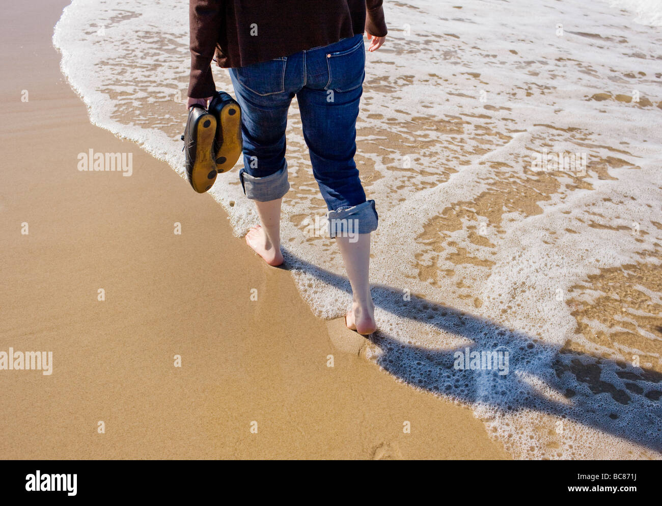 A joung woman take a walk on the beach Stock Photo