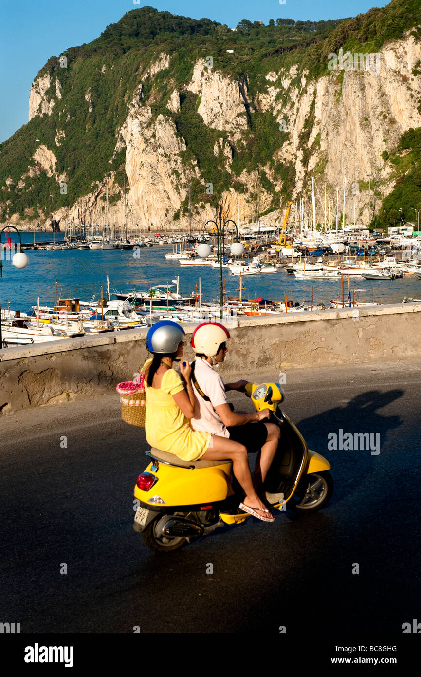 Couple on scooter Capri Italy - Stock Image