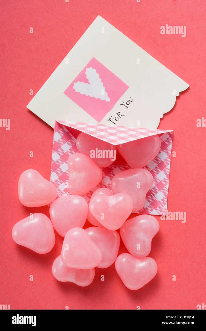 pink heart shaped sweets and valentine card stock photo 24776420
