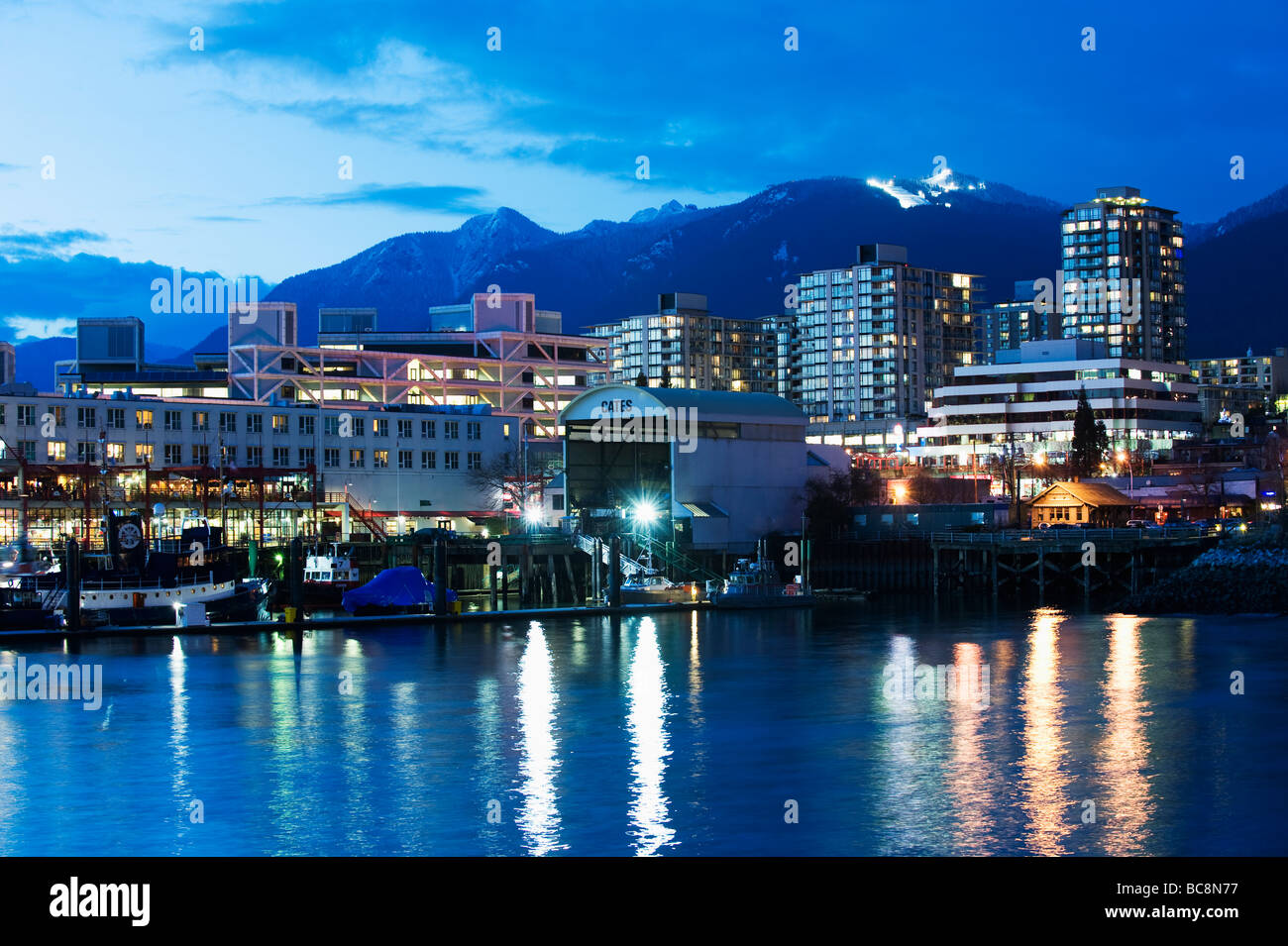 north vancouver skyline and grouse mountain ski resort above stock