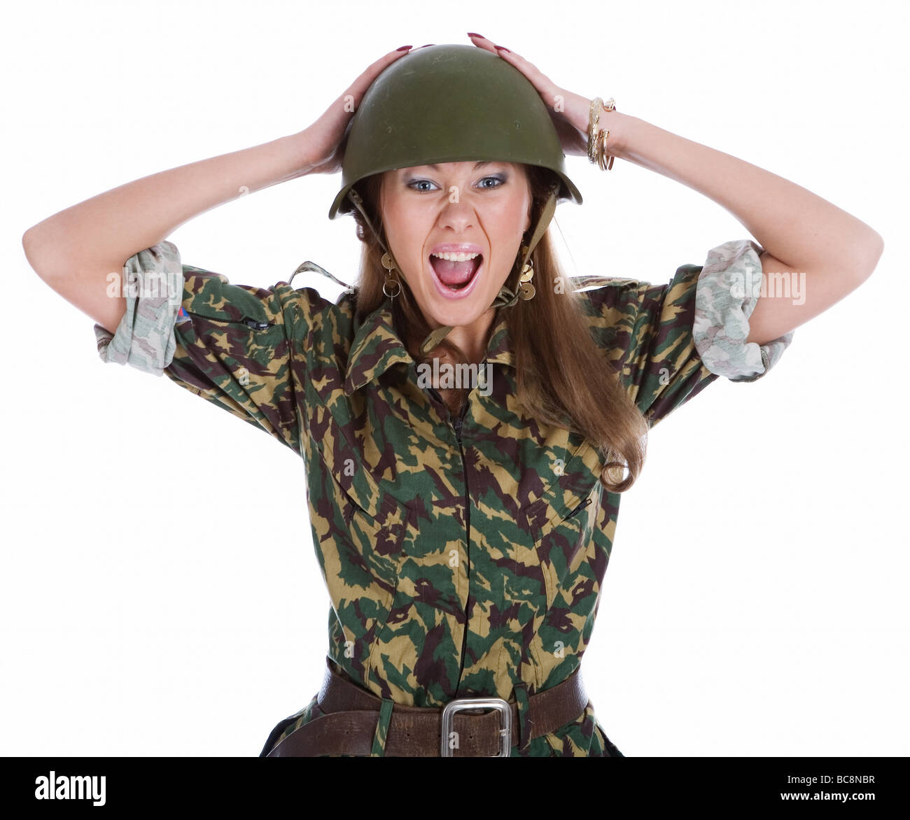 woman in a steel helmet on white background - Stock Image