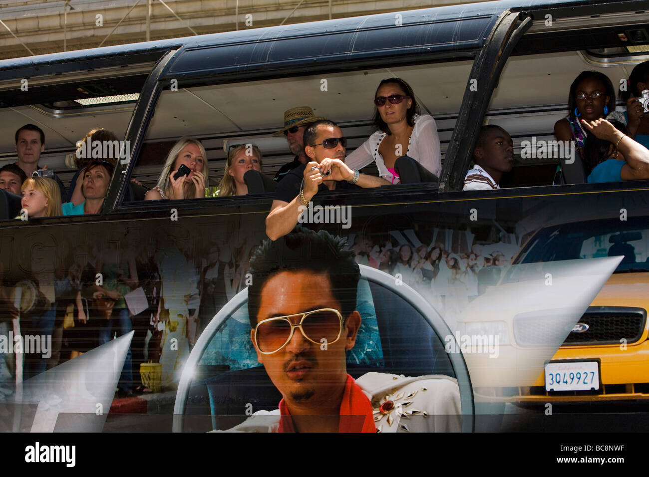 Tourists on a bus sightseeing Hollywood Blvd Hollywood Los Angeles County California United States of America - Stock Image