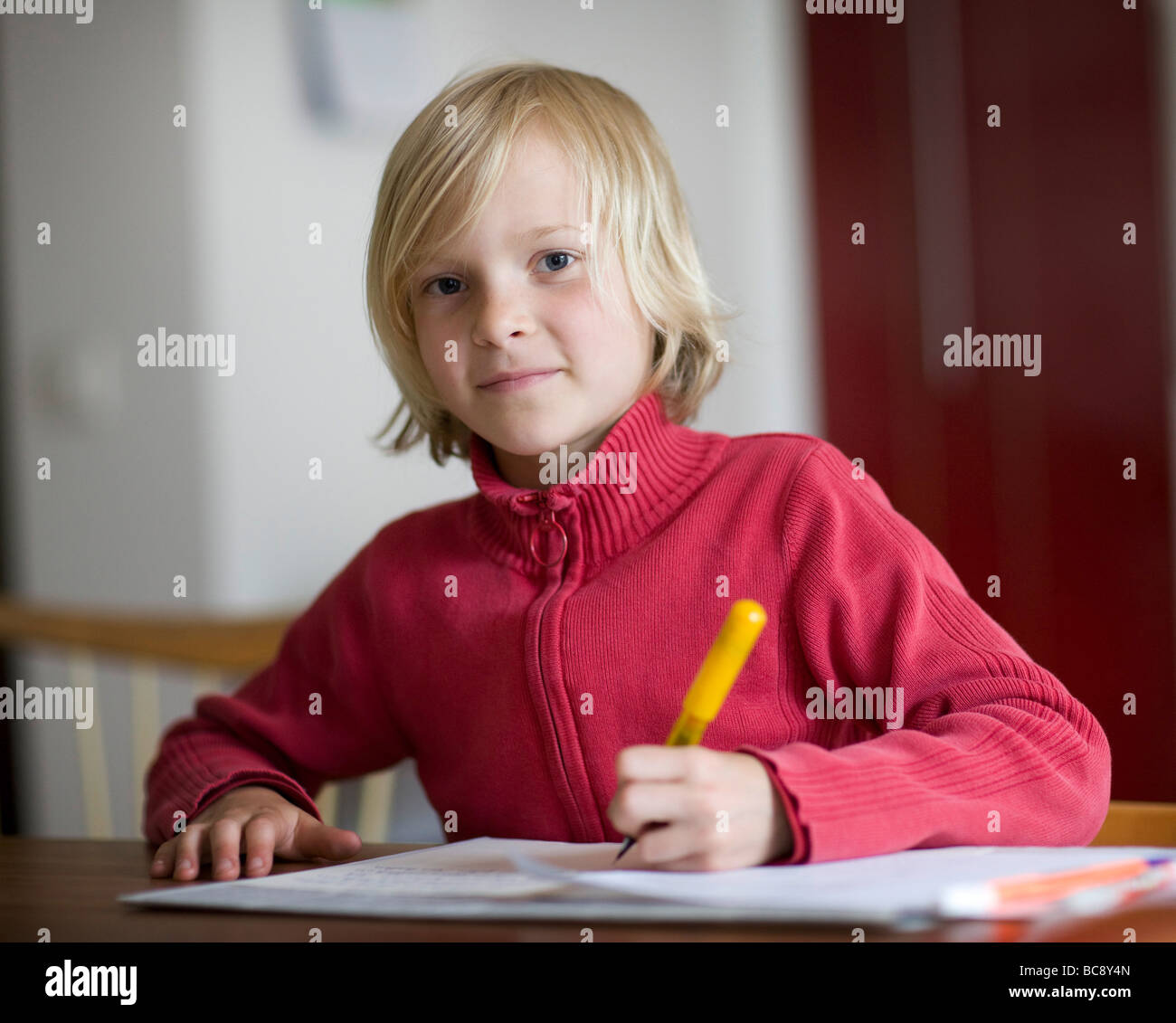 a girl is doing her homework - Stock Image
