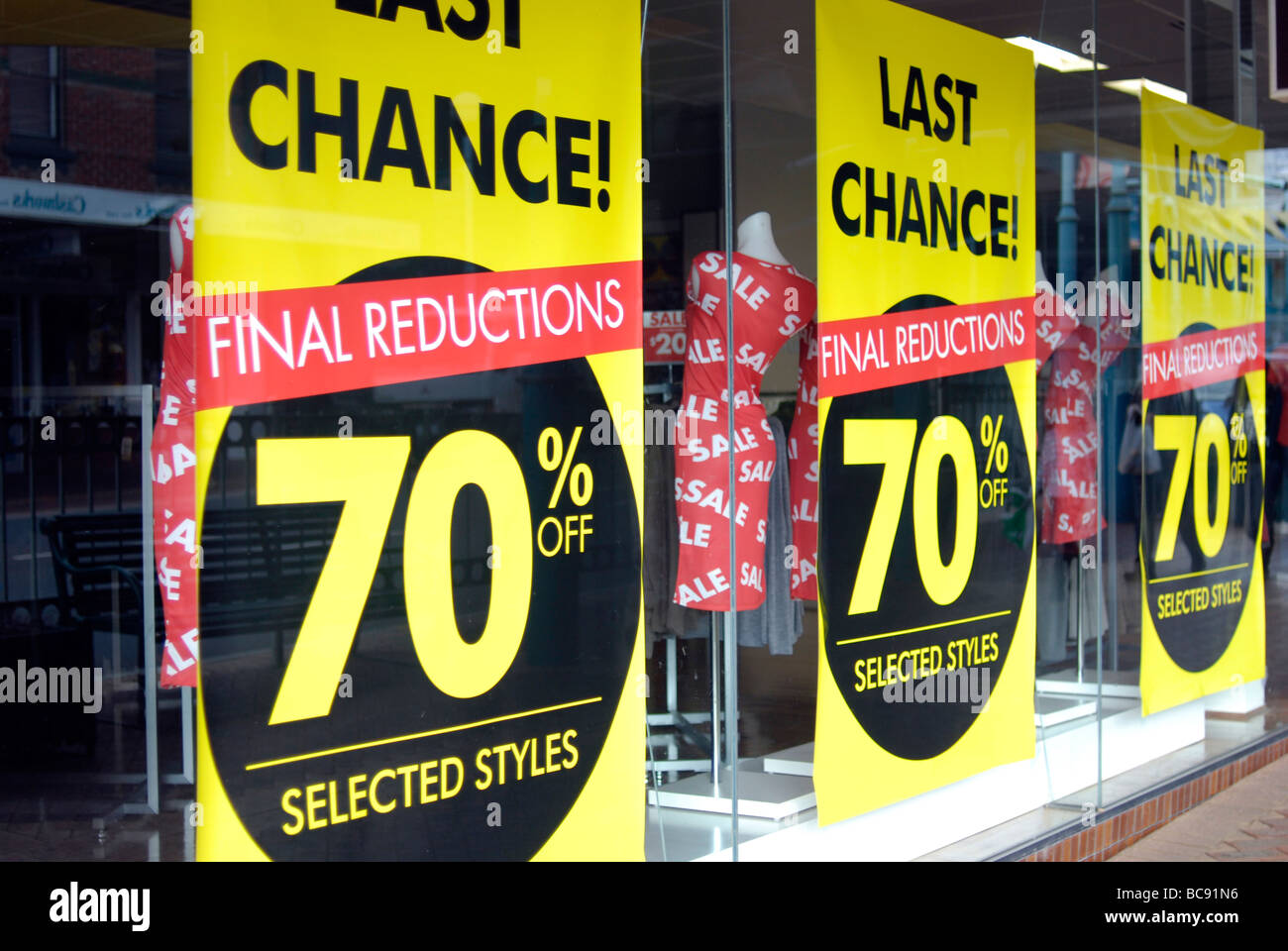 Sale sign in shop window - Stock Image
