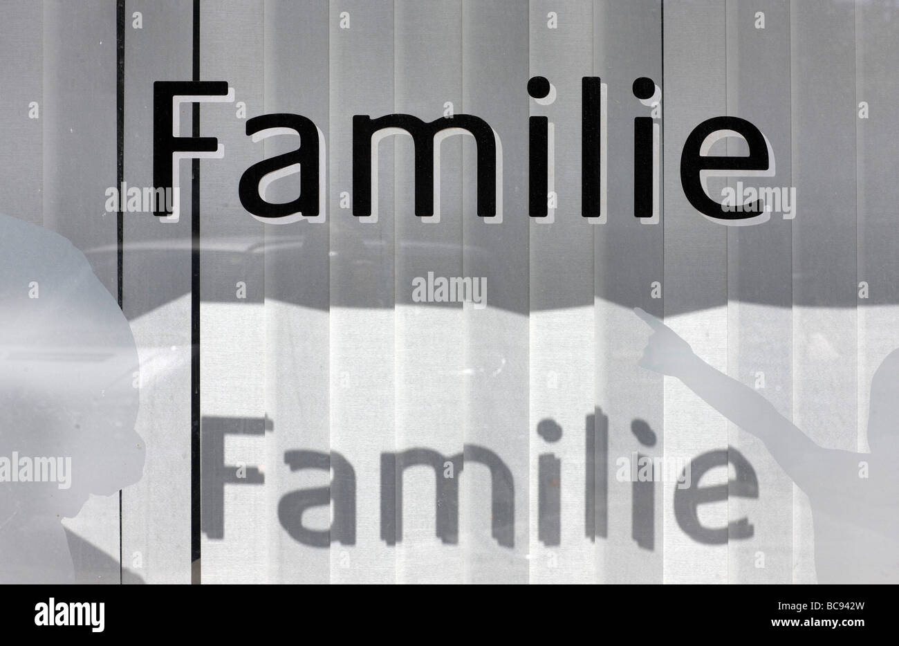 Familie Writing at a window - Stock Image