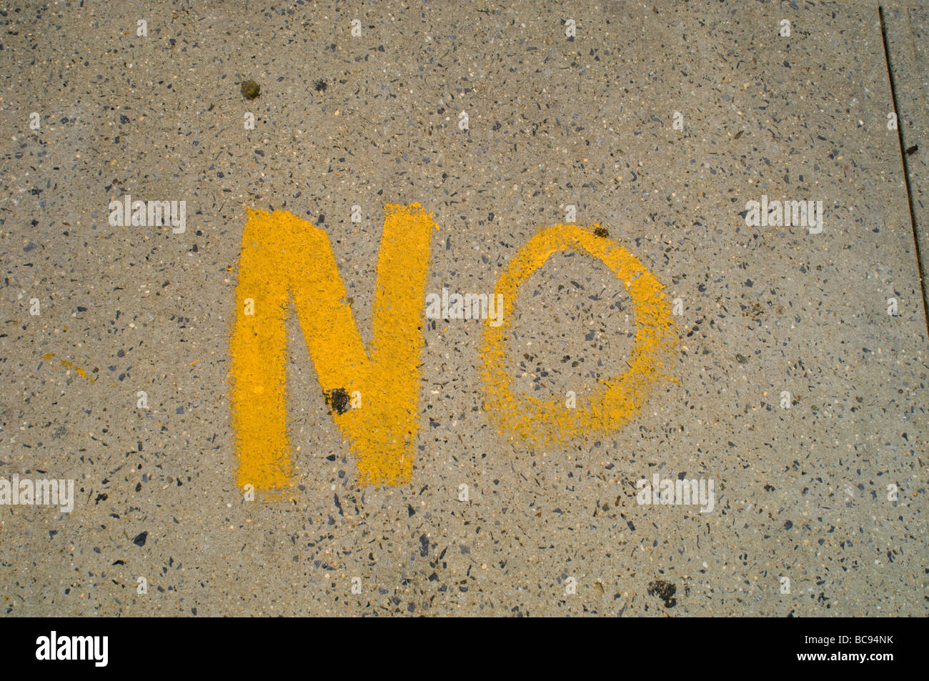 The word No written on the sidewalk in Astoria Queens in New York on June 27 2009 Frances M Roberts - Stock Image
