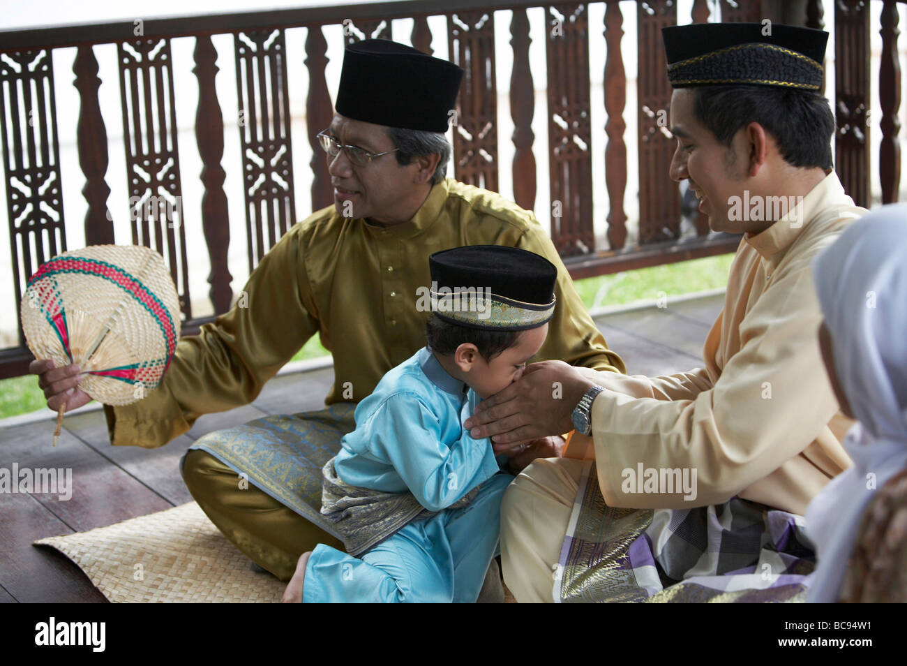 kid greeting to family member - Stock Image