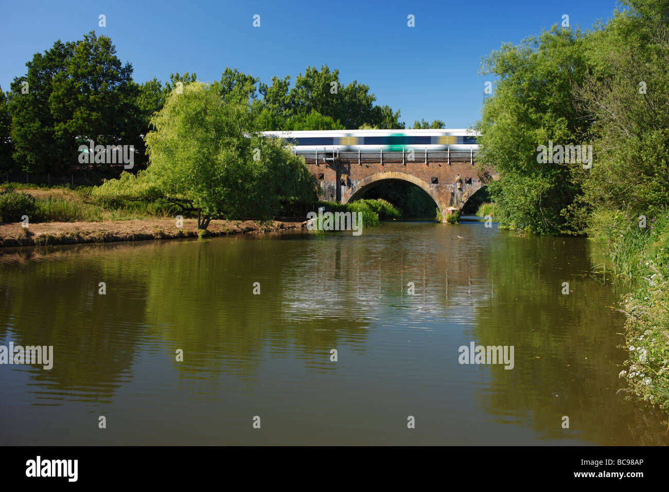 Train passing over a Railway viaduct over the river Medway Haysden country park Tonbridge Kent England UK - Stock Image