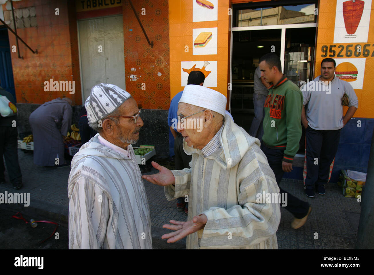 Spanish muslims talk in the streets of Melilla Spain - Stock Image