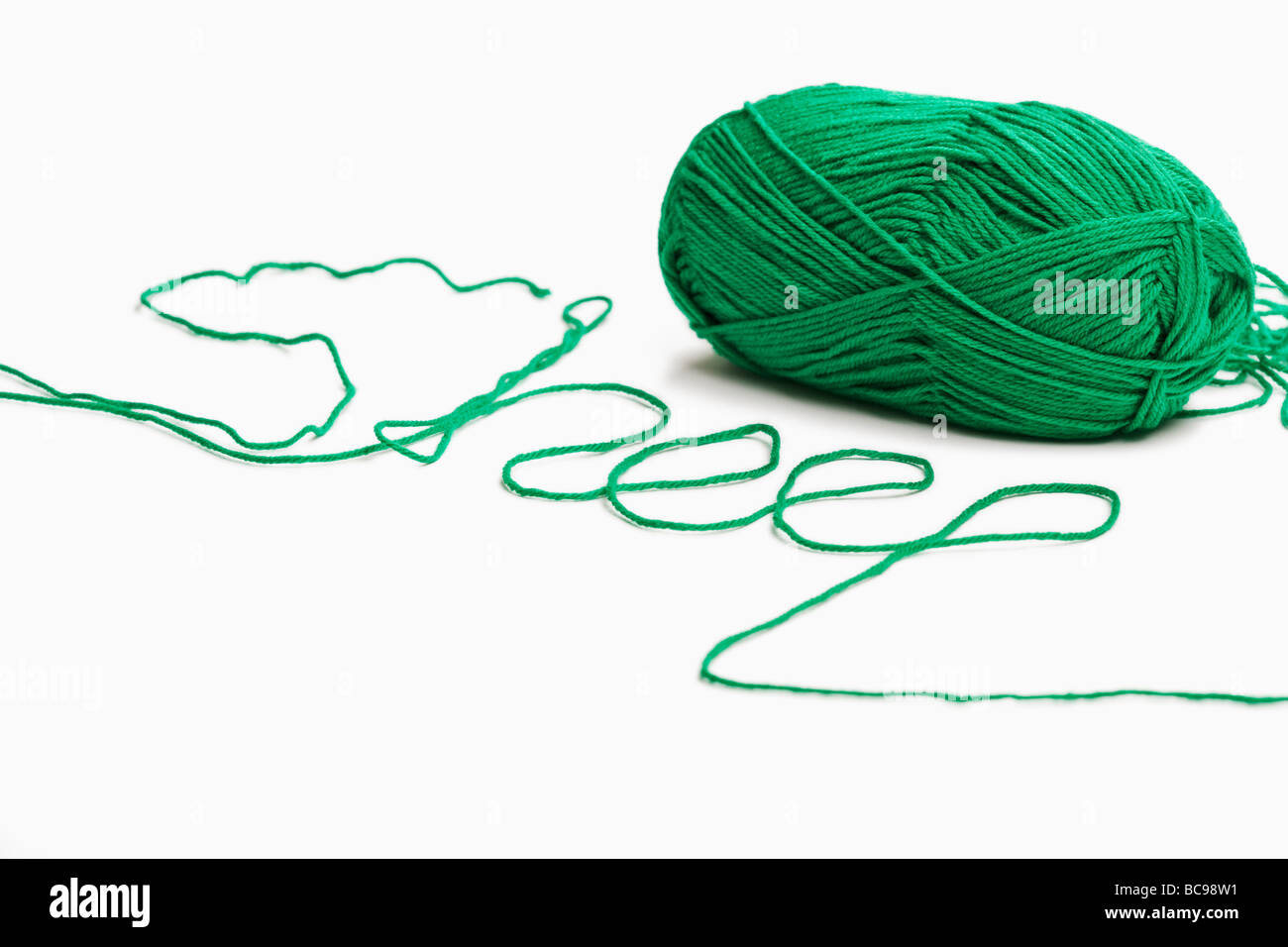 Green wool spelling the word sheep - Stock Image