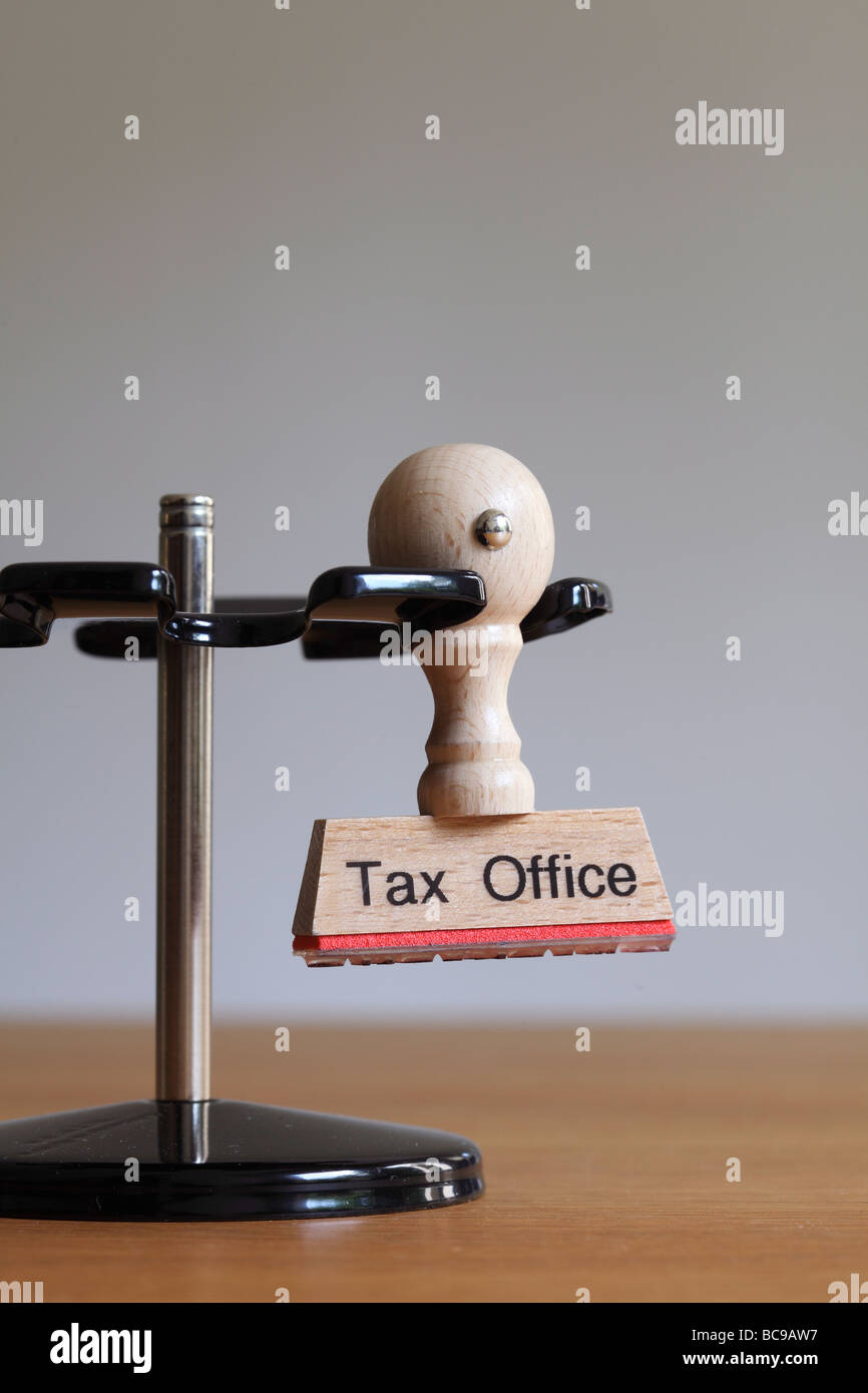 Stamp with inscription Tax Office - Stock Image