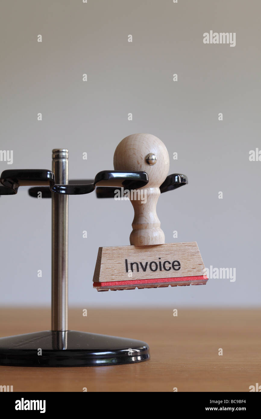 Stamp with inscription Invoice - Stock Image
