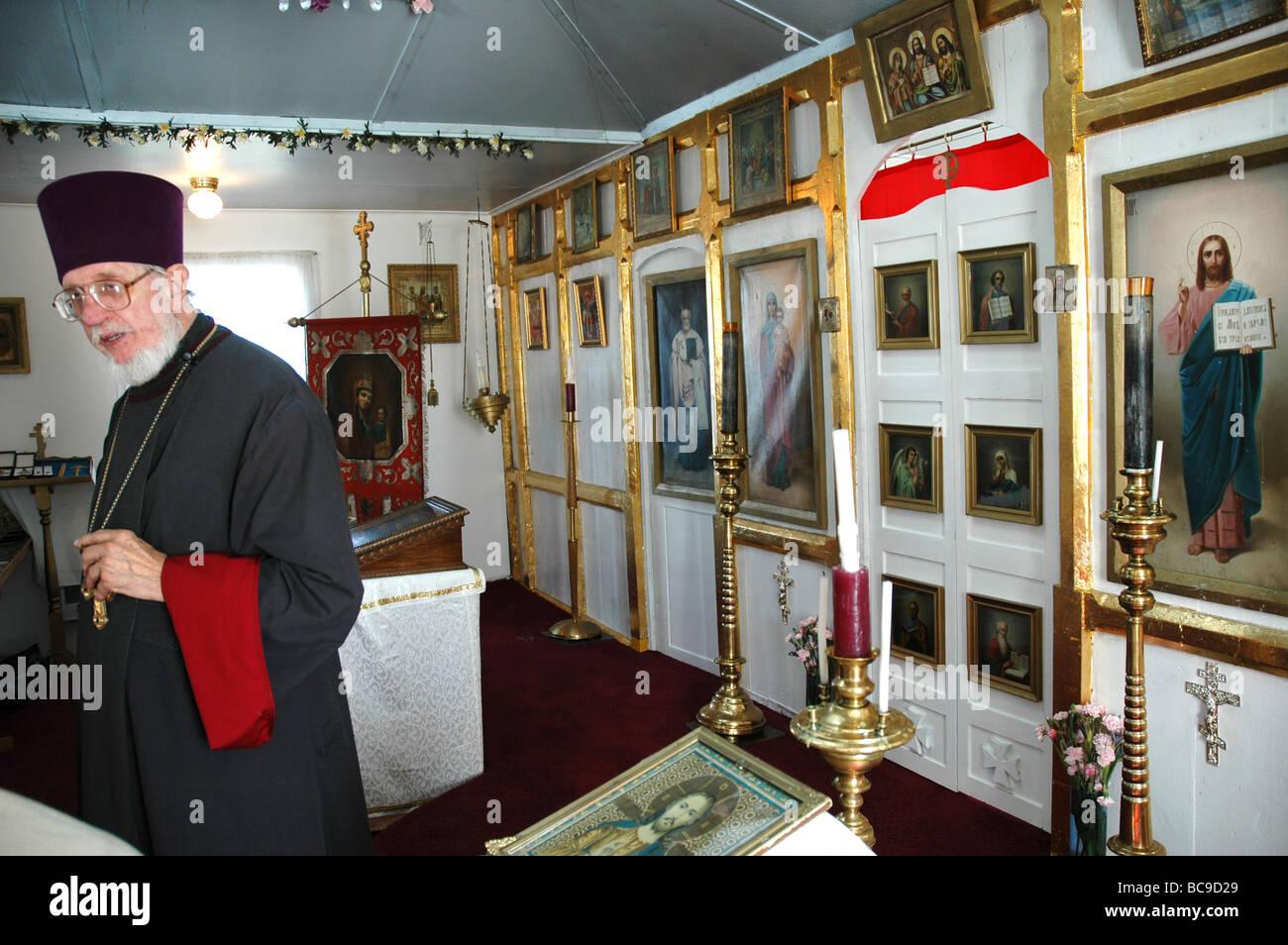 Russian Orthodox Priest in his  church in Ninilchik, Alaska, USA - Stock Image