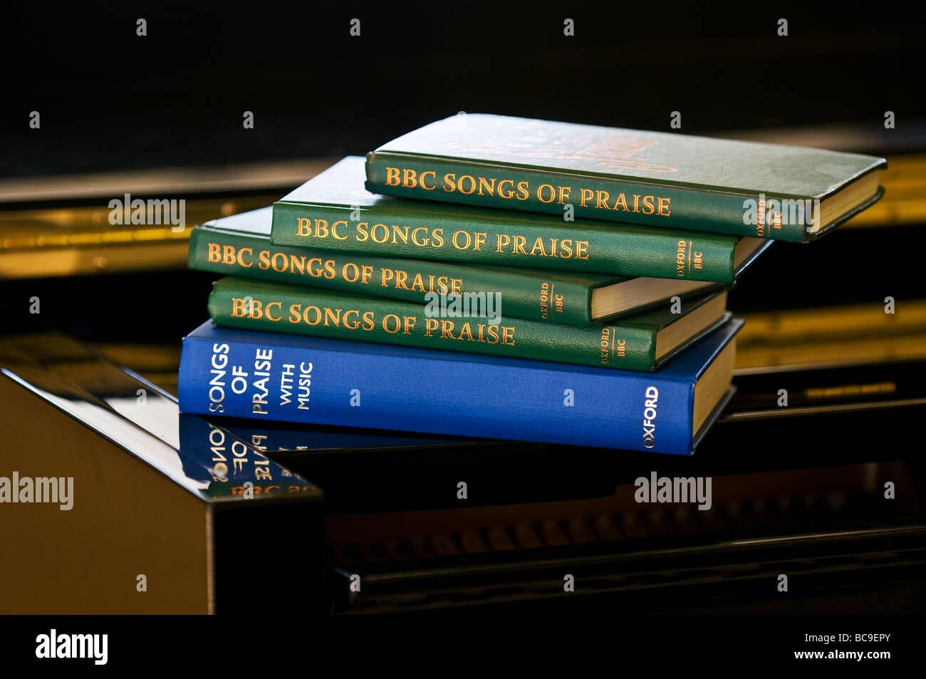A pile of hymn books. - Stock Image