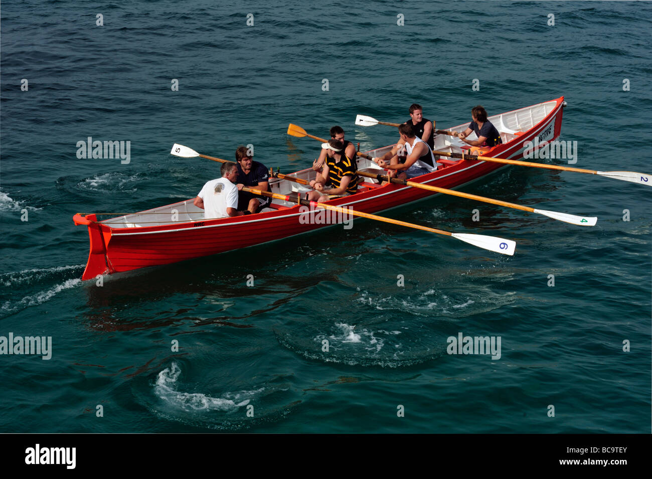 Gig Rowing Boat practising in Newquay Harbour - Stock Image