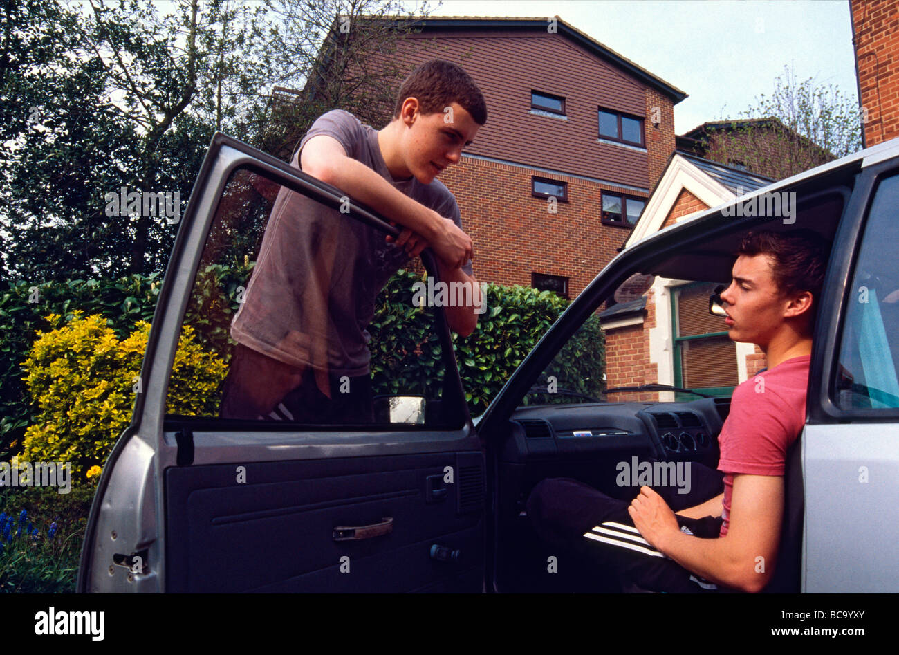 Non-identical twin brothers outside their house Kent England - Stock Image