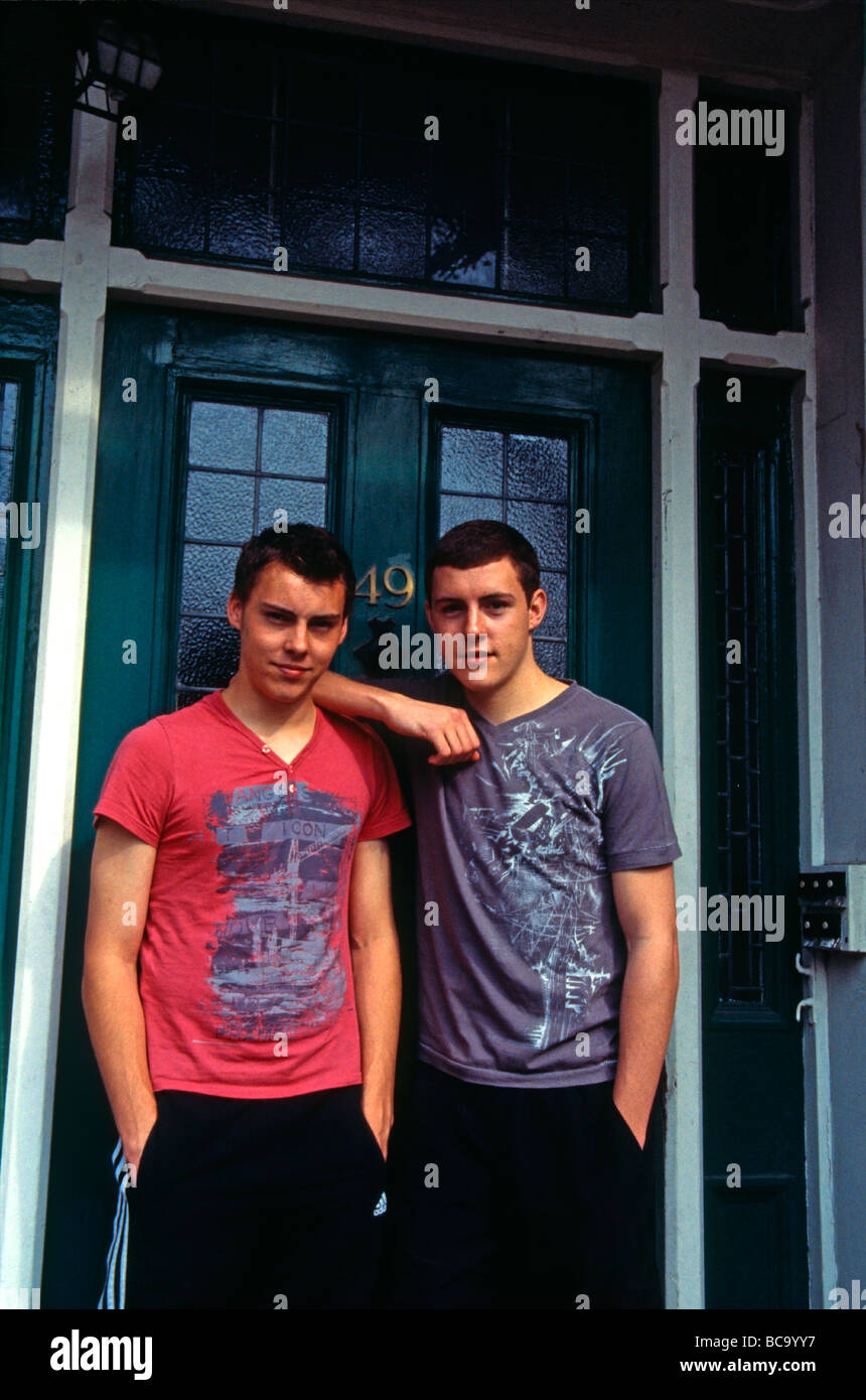 Non identical twin brothers outside their house Kent England - Stock Image