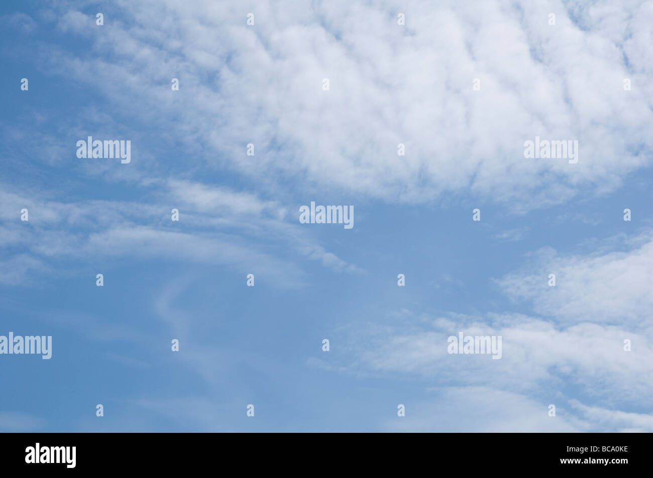 Soft thin fluffy clouds developing into a blanket. - Stock Image