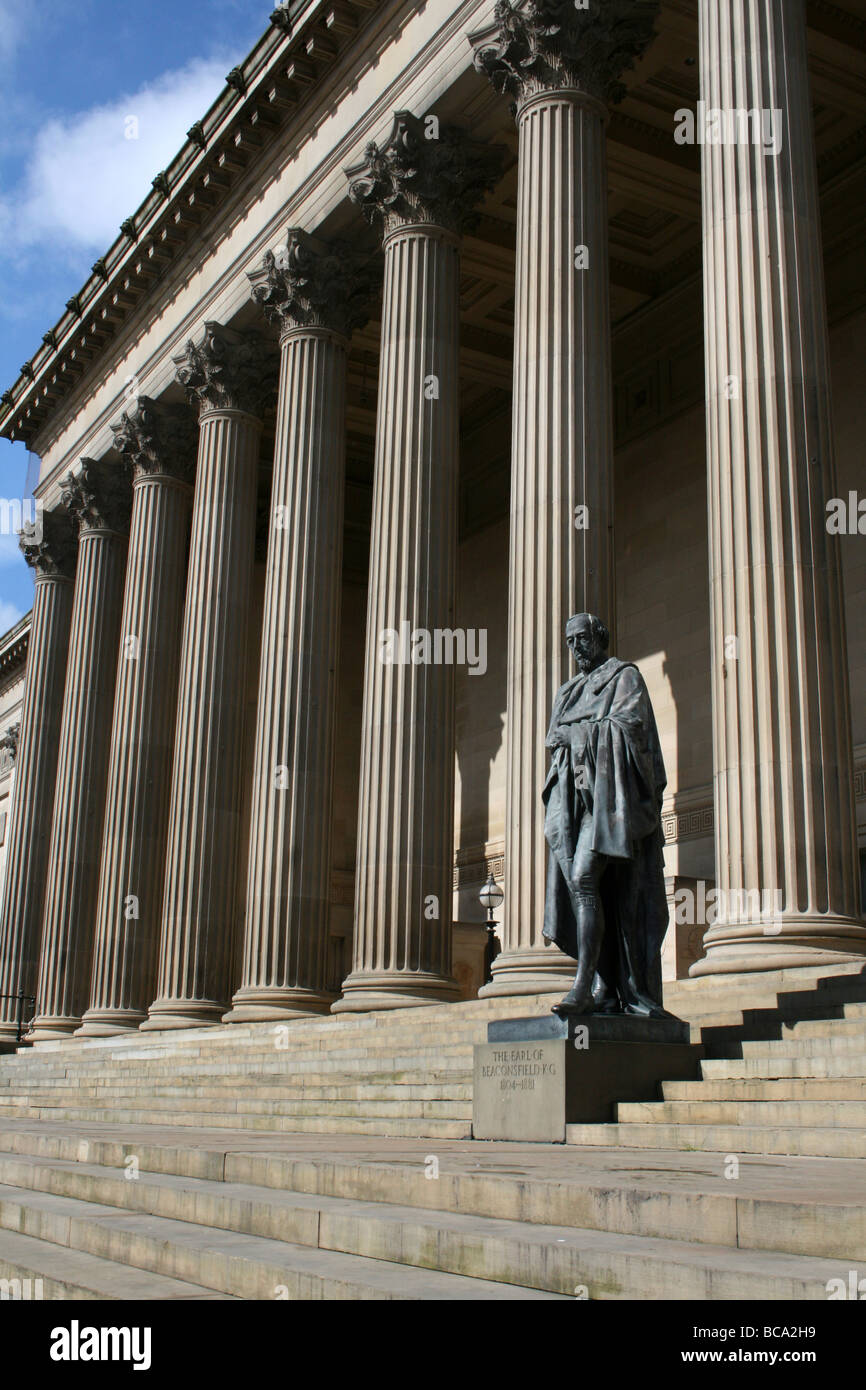 Statue Of Benjamin Disraeli Standing In Front Of Corinthian Columns At St George's Hall, Liverpool, Merseyside, - Stock Image