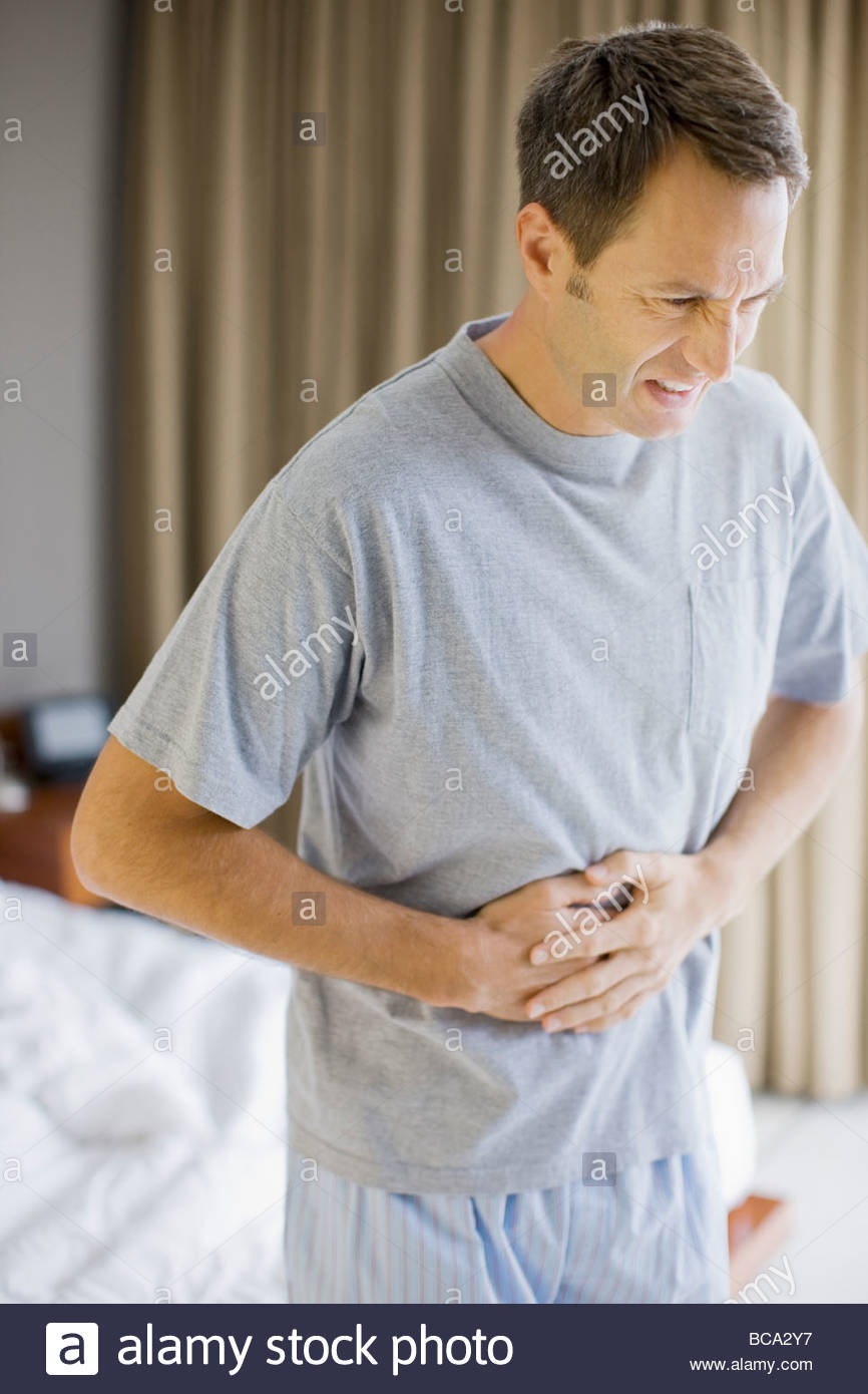 Man with stomachache - Stock Image
