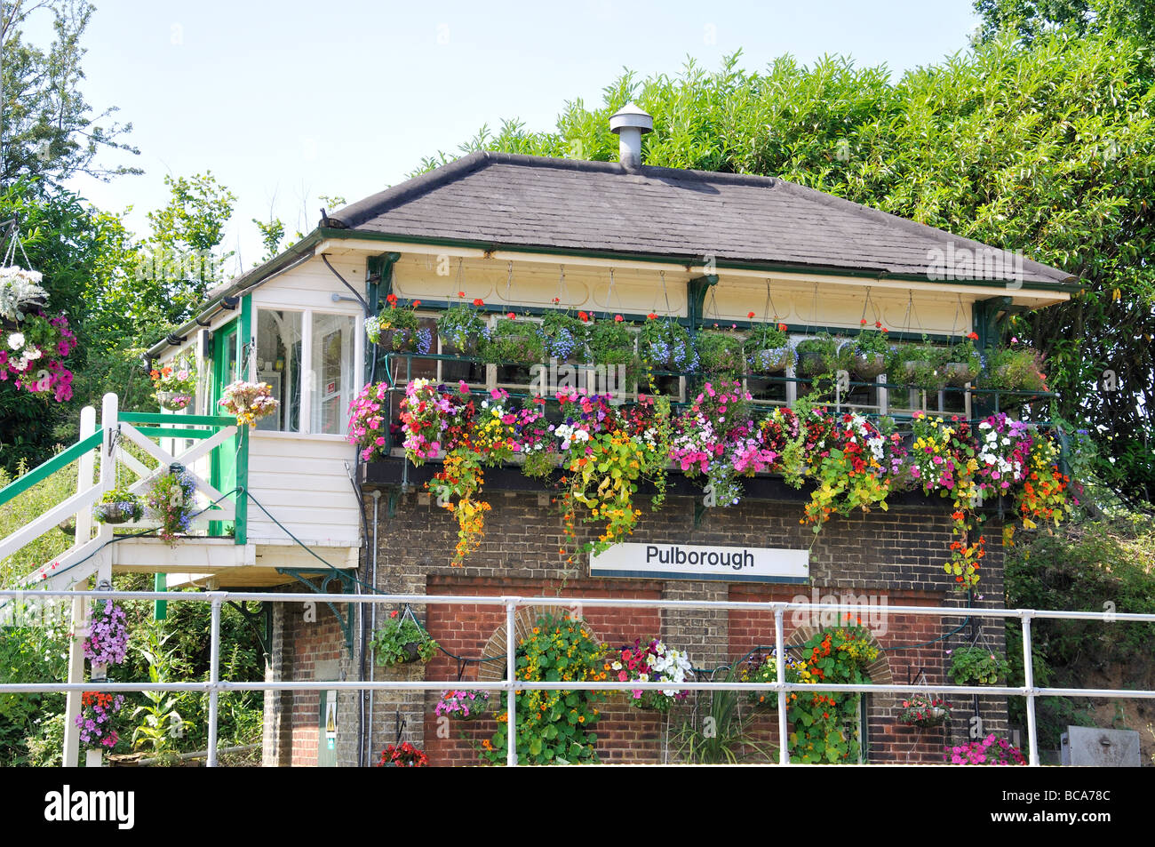 Flower-clad Pulborough Station Signal Box, Pulborough, West Sussex, England, United Kingdom - Stock Image