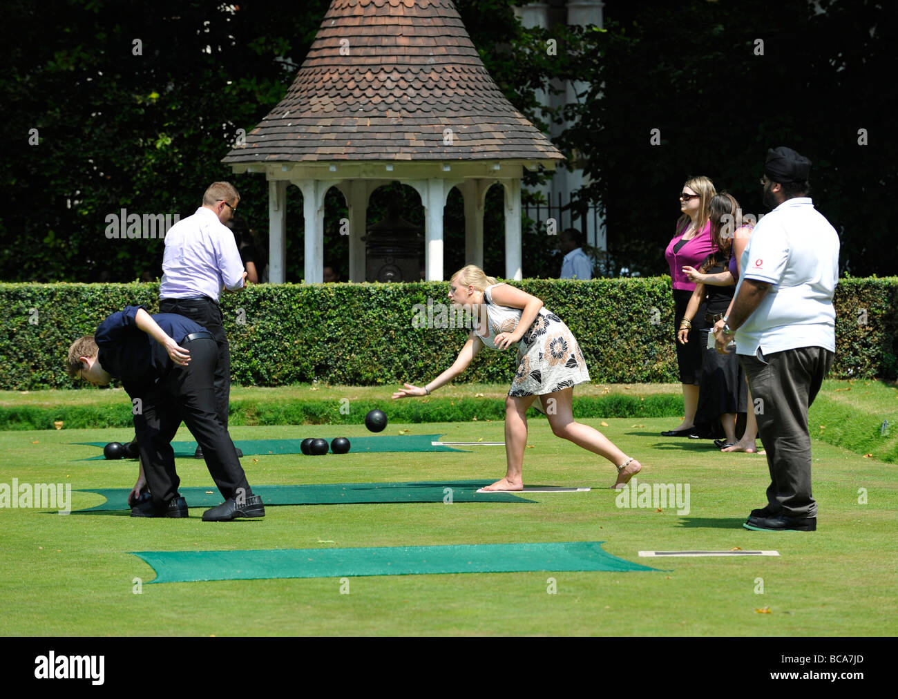 City of London workers take to the outside spaces during their lunch break in the heatwave. Bowling in Finsbury - Stock Image